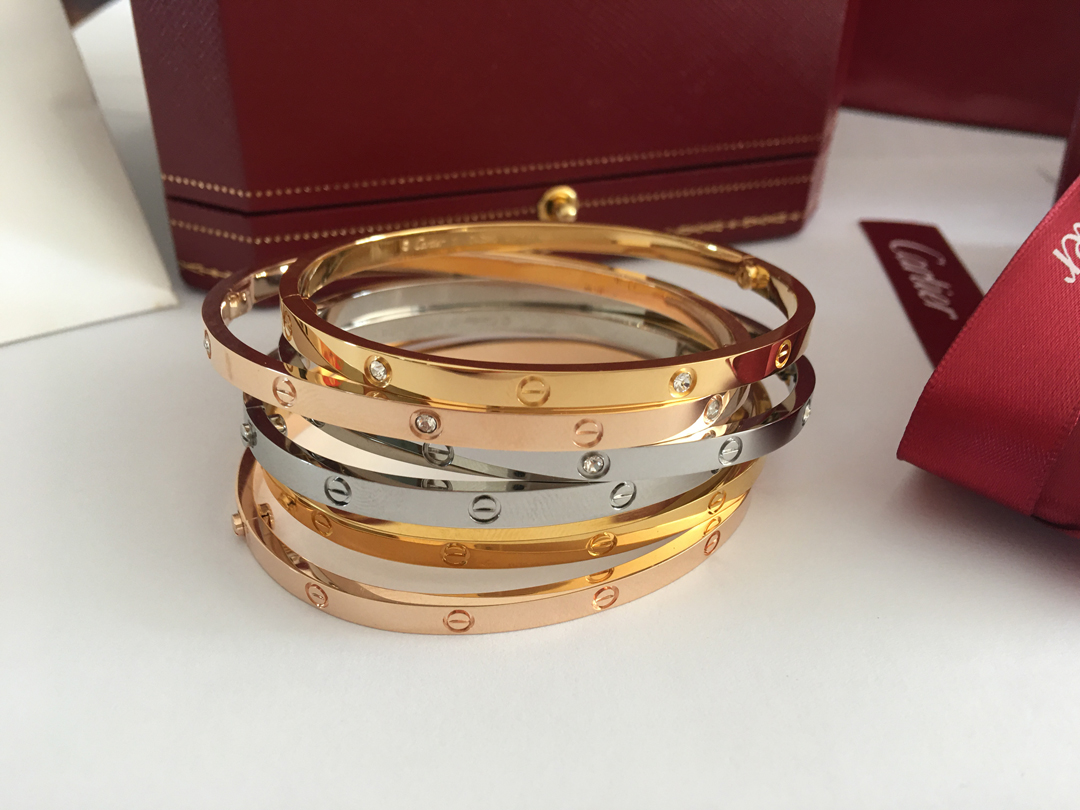 Cartier LOVE Bracelet. New design / Small Model. Yellow Gold, Pink Gold, White Gold